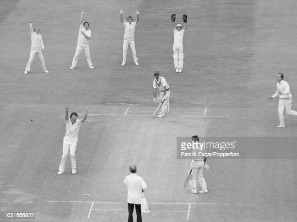 England appeal for LBW against Indian batsman Yashpal Sharma as umpire David Evans raises his hand to give him out and Derek Pringle takes his first...