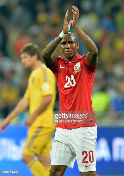 England Ashley Young greets the fans after Brazil 2014 FIFA World Cup qualifiers Group H football match with Ukraine in Kiev on September 10 2013 The...