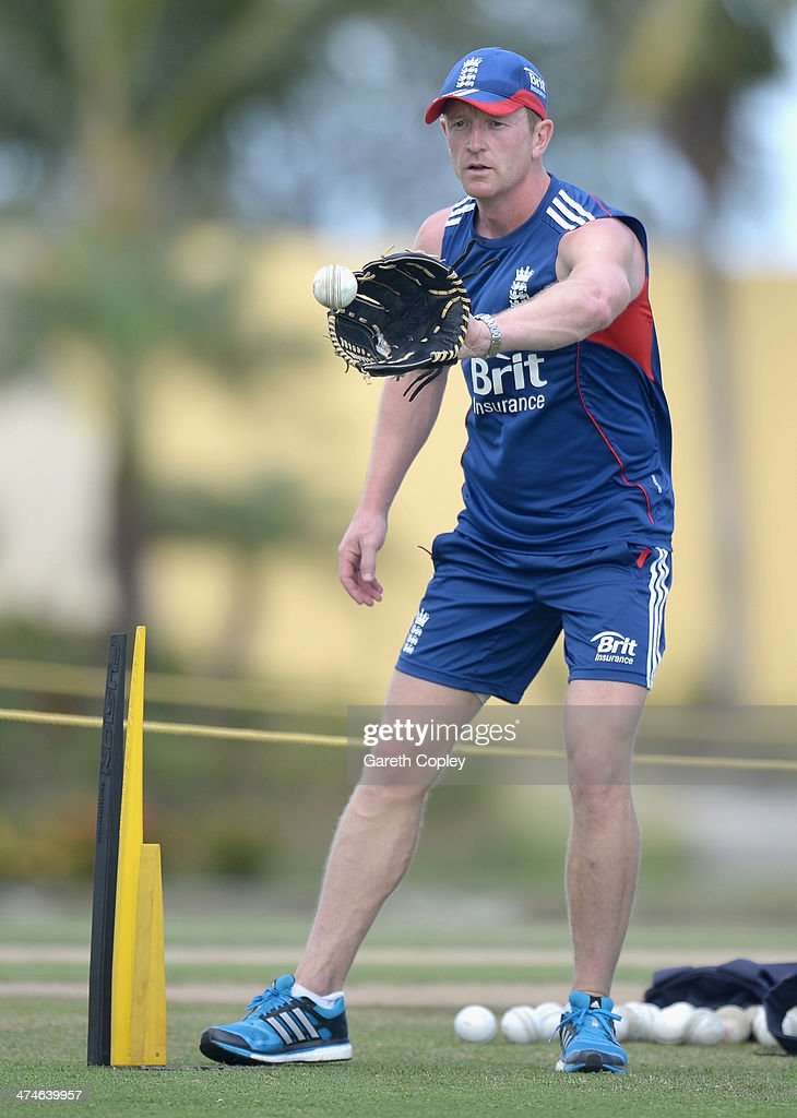 England assistant coach Paul Collingwood holds a fielding drill during a nets session at Sir Viv Richards Cricket Ground on February 24, 2014 in Antigua, Antigua and Barbuda.