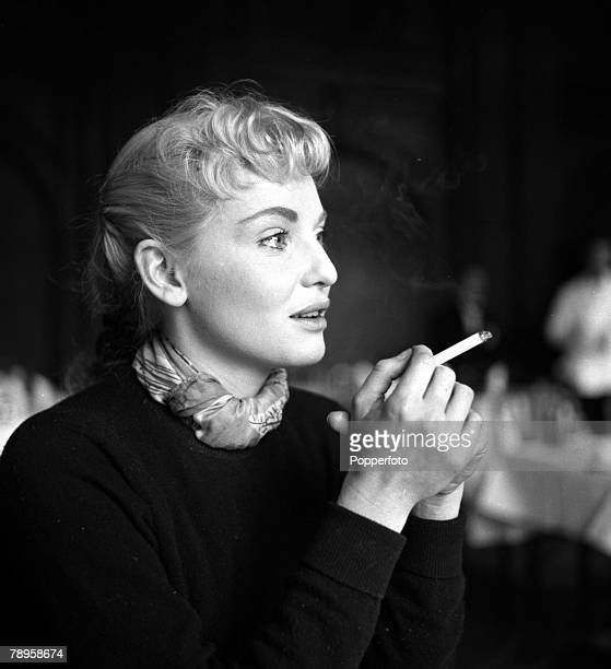 England Australian actress Diane Cilento is pictured smoking a cigarette
