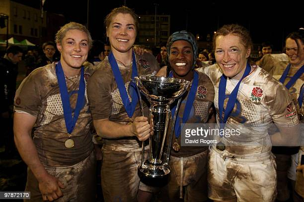 England back rowers Heather Fisher, Catherine Spencer, Margaret Alphonsi and Karen Jones of England celebrate with the trophy after they won the...