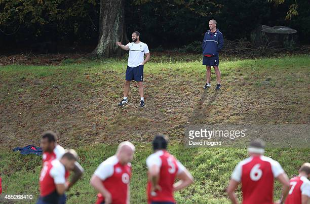 England backs coach Andy Farrell and head coach Stuart Lancaster look on during the England training session held at Pennyhill Park on August 26 2015...