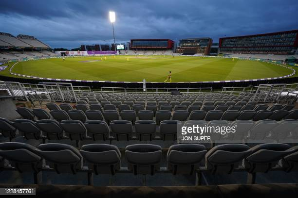 England bat under the floodlights in the empty ground during the one-day international cricket match between England and Australia at Old Trafford in...