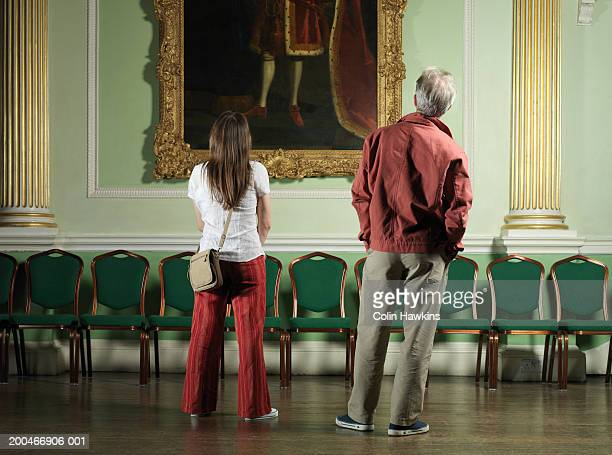england, bath, mature couple looking at painting, rear view - colin hawkins stock pictures, royalty-free photos & images