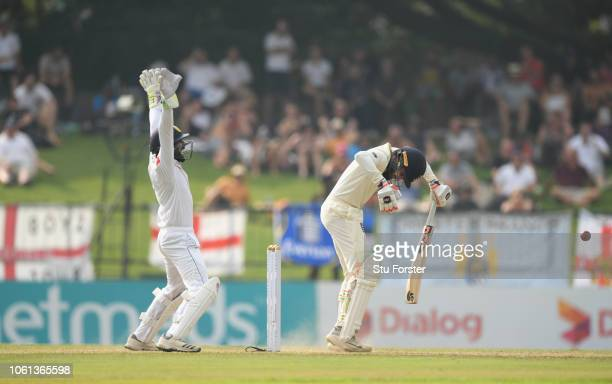 England batsman Adil Rashid is LBW for 31 as Niroshan Dickwella appeals during Day One of the Second Test match between Sri Lanka and England at...
