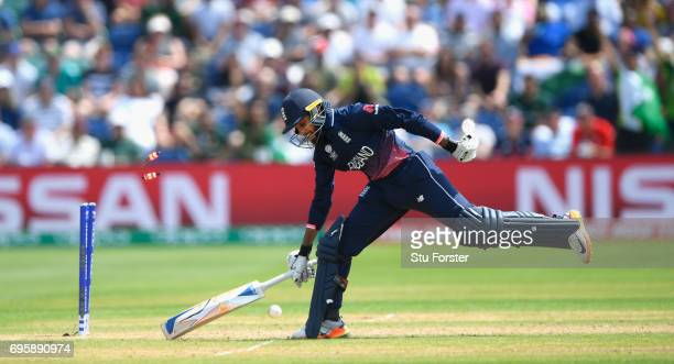 England batsman Adil Rashid is run out during the ICC Champions Trophy semi final between England and Pakistan at SWALEC Stadium on June 14 2017 in...