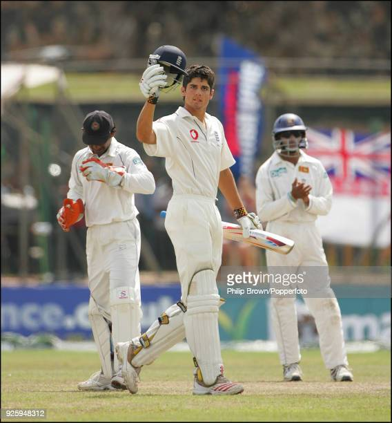 England batsman Alastair Cook celebrates reaching his century during his innings of 118 in the 3rd Test match between Sri Lanka and England at Galle...