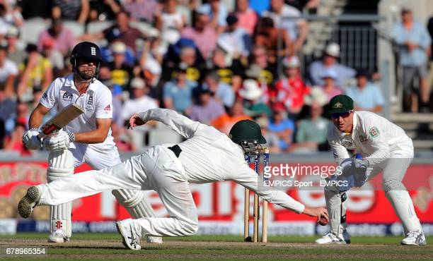 England batsman Alastair Cook has his stop stoped by the dive from Australia fielder Steve Smith during day two of the Third Investec Ashes test...