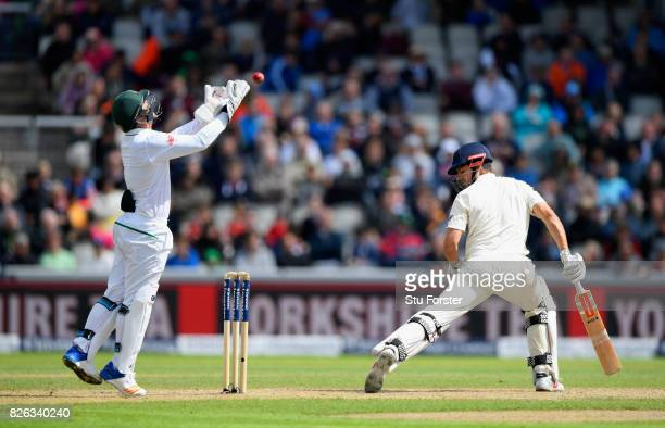 England batsman Alastair Cook is caught behind by Quinton de Kock during day one of the 4th Investec Test match between England and South Africa at...
