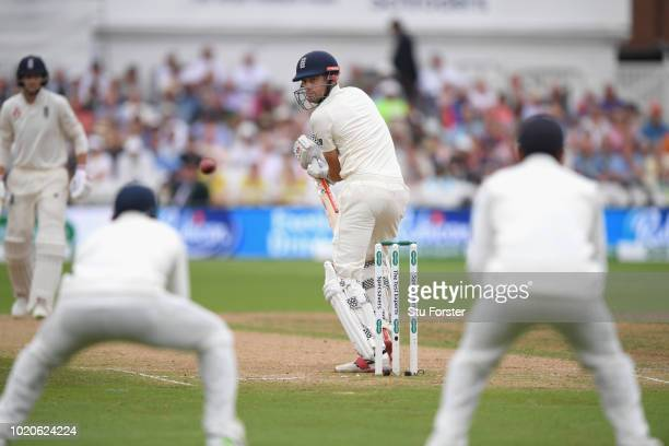 England batsman Alastair Cook looks behind after edging the ball to Rahul off the bowling of Ishant Sharma for 17 runs during day four of the 3rd...
