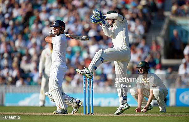 England batsman Alastair Cook picks up some runs despite the attentions of keeper Peter Nevil during day three of the 5th Investec Ashes Test match...