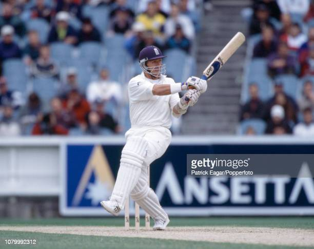 England batsman Alec Stewart hits out during his innings of 107 in the 4th Test match between Australia and England at the MCG, Melbourne, 27th...
