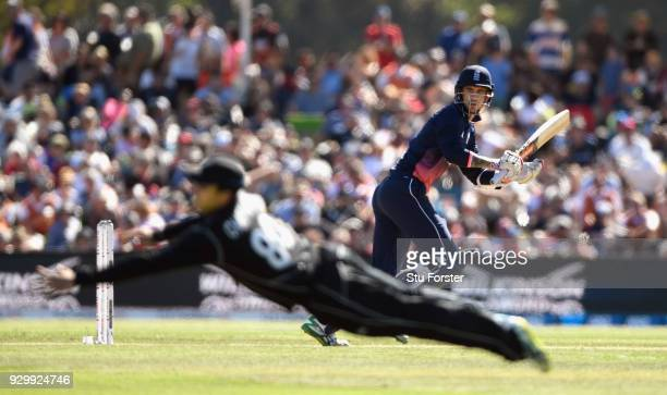 England batsman Alex Hales cuts a ball to the boundary despite the dive of Mark Chapman during the 5th ODI between New Zealand and England at Hagley...