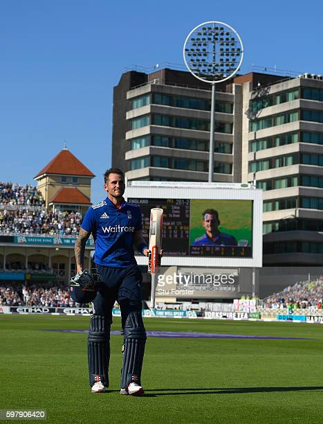 England batsman Alex Hales raises his bat as he leaves the field after scoring 171 the highest by an English batsman in a One Day International...