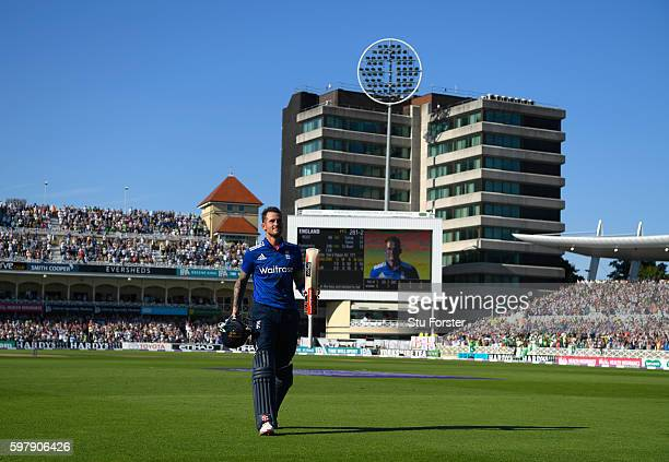 England batsman Alex Hales raises his bat as he leaves the field after scoring 171, the highest by an English batsman in a One Day International...