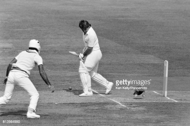 England batsman Allan Lamb loses his helmet after being hit by a bouncer during his innings of 33 in the 2nd Test match between England and Pakistan...
