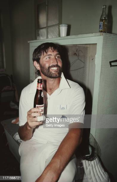 England batsman and man of the match Graham Gooch enjoys a beer in the dressing room after the drawn 5th and final Test Match against the West Indies...