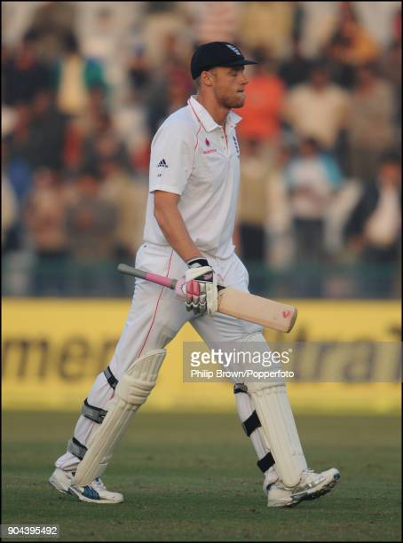 England batsman Andrew Flintoff walks off after being dismissed for 62 during the 2nd Test match between India and England at the Punjab Cricket...