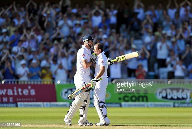 England batsman Andrew Strauss celebrates with teammate Kevin Pietersen after reaching 100 not out on the second day of the second Test match between...