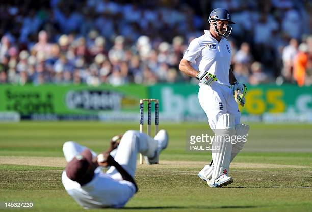 England batsman Andrew Strauss has his shot stopped on the second day of the second Test match between England and West Indies at Trent Bridge in...
