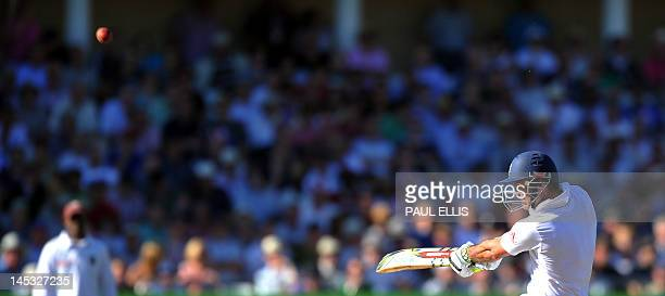 England batsman Andrew Strauss hits out on the second day of the second Test match between England and West Indies at Trent Bridge in Nottingham...