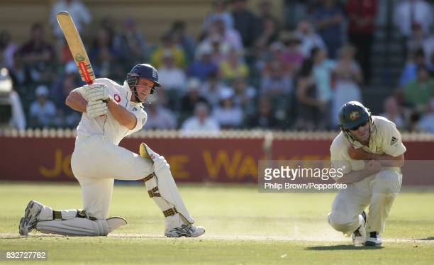 England batsman Andrew Strauss hits the ball past Australian fielder Michael Hussey towards the end of day four of the 2nd Test match between...