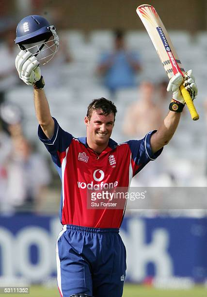 England batsman Andrew Strauss raises his bat after reaching his century during The Natwest Series Match between England v Bangladesh at Trent Bridge...