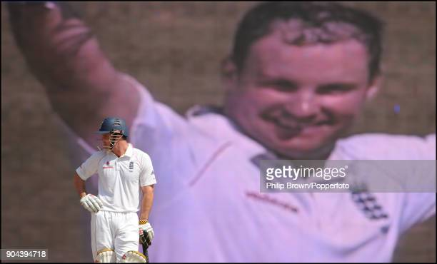 England batsman Andrew Strauss waits for play to continue as a big screen shows his celebration on reaching 100 runs for the second time in the match...