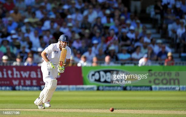 England batsman Andrew Strauss watches his shot on the second day of the second Test match between England and West Indies at Trent Bridge in...