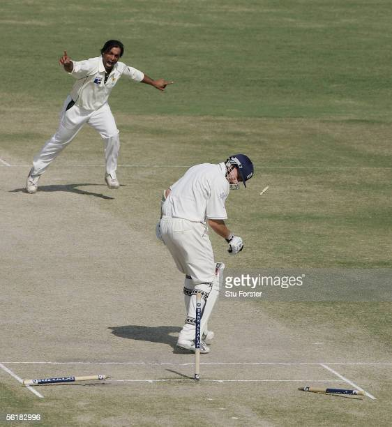 England batsman Ashley Giles is bowled by Pakistan bowler Shoaib Akhtar during the Fifth day of the First Test Match between Pakistan and England at...