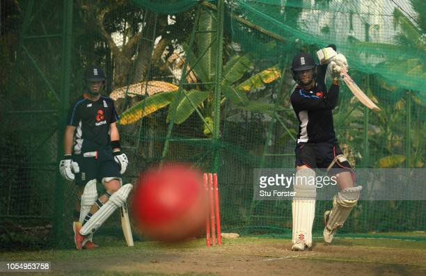 England batsman Ben Foakes cuts a ball as Ollie Pope looks on during England nets at the NCCC on October 29 2018 in Colombo Sri Lanka