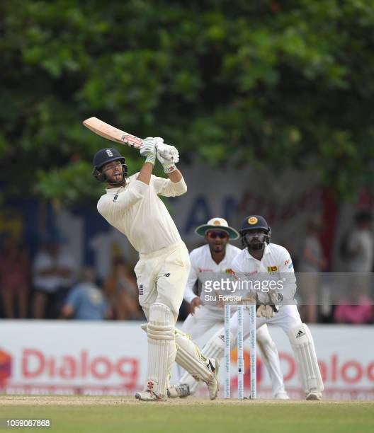 England batsman Ben Foakes hits a six during Day Three of the First Test match between Sri Lanka and England at Galle International Stadium on...