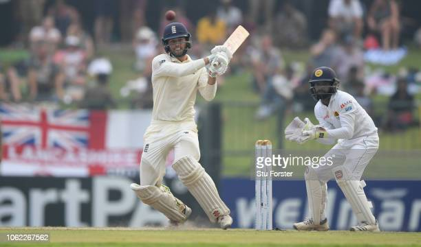 England batsman Ben Foakes hits out watched by wicketkeeper Niroshan Dickwella during Day Three of the Second Test match between Sri Lanka and...