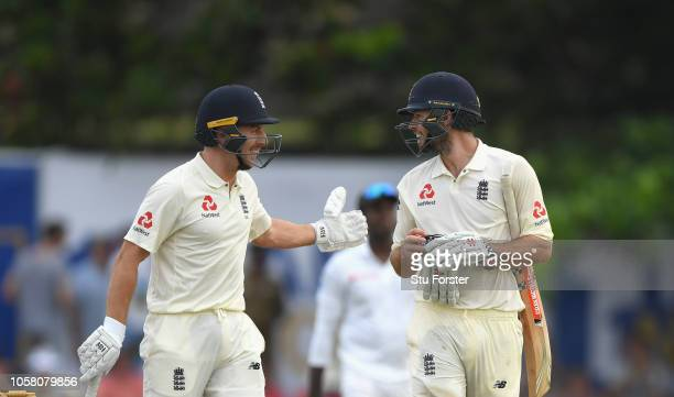 England batsman Ben Foakes is congratulated after reaching close of play unbeaten on 87 runs on his debut with Jack Leach after Day One of the First...