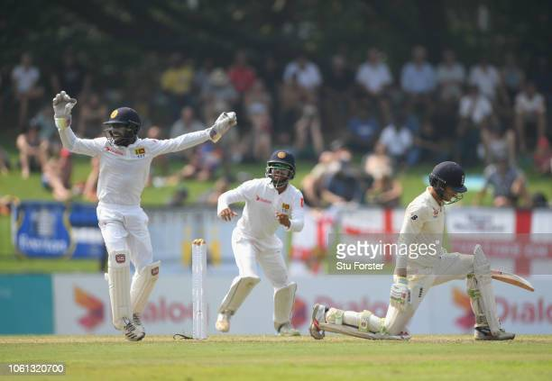 England batsman Ben Foakes looks on as Niroshan Dickwella celebrates after Foakes is caught at slip for 19 runs during Day One of the Second Test...