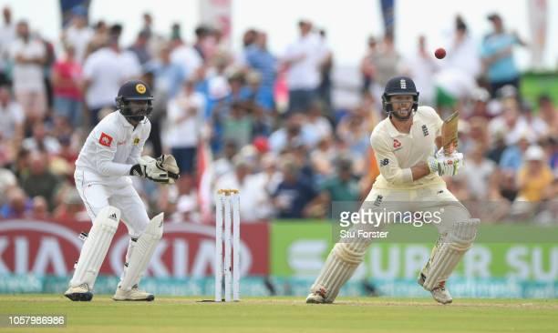 England batsman Ben Foakes picks up runs as Sri Lanka wicketkeeper Niroshan Dickwella looks on during Day One of the First Test match between Sri...