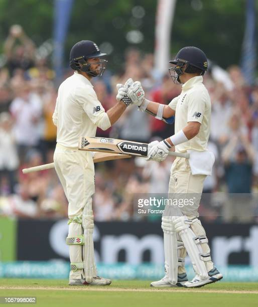 England batsman Ben Foakes reaches 50 on debut and is congratulated by Sam Curran during Day One of the First Test match between Sri Lanka and...