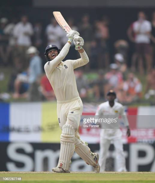 England batsman Ben Foakes reaches his half century with a six over square leg during Day Three of the Second Test match between Sri Lanka and...