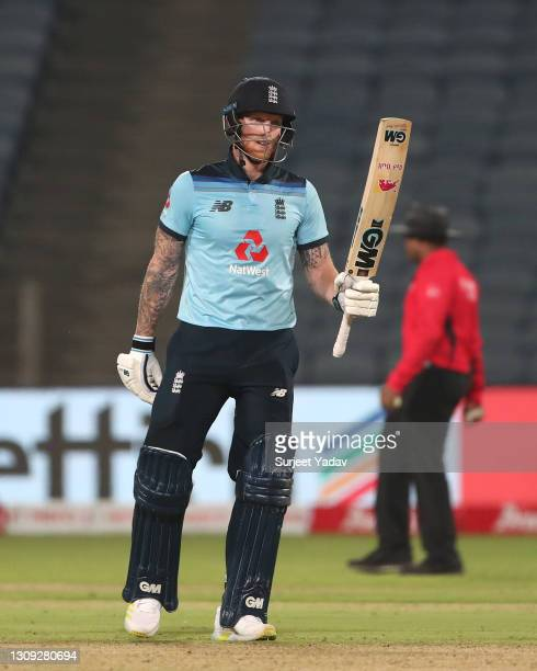 England batsman Ben Stokes celebrates his half century during the 2nd One Day International between India and England at MCA Stadium on March 26,...