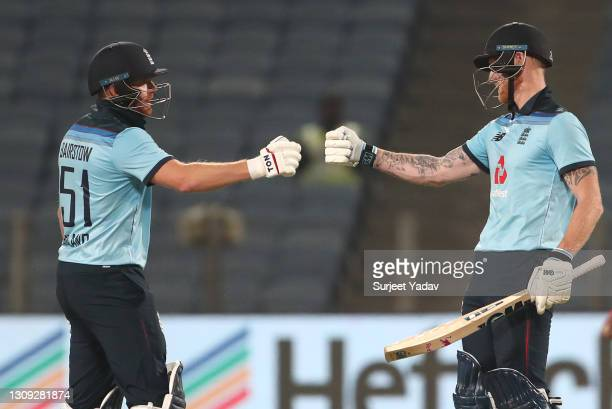 England batsman Ben Stokes celebrates his half century with Jonny Bairstow during the 2nd One Day International between India and England at MCA...