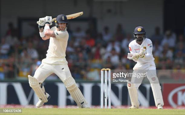 England batsman Ben Stokes cuts a ball to the boundary watched by Niroshan Dickwella during Day One of the Third Test match between Sri Lanka and...