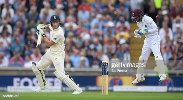 England batsman Ben Stokes cuts a ball to the boundary watched by keeper Shane Dowrich during day one of the 2nd Investec Test match between England...