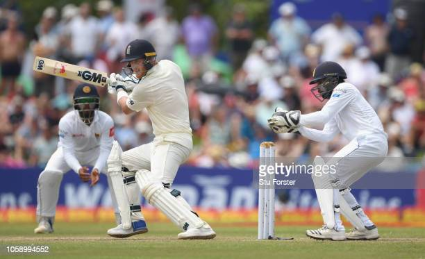 England batsman Ben Stokes cuts the ball to pick up some runs watched by Sri Lanka wicketkeeper Niroshan Dickwella during Day three of the First Test...