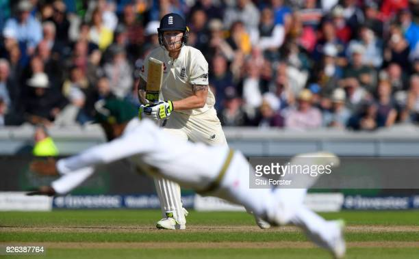 England batsman Ben Stokes drives a ball to the boundary despite the dive of Temba Bavuma during day one of the 4th Investec Test match between...