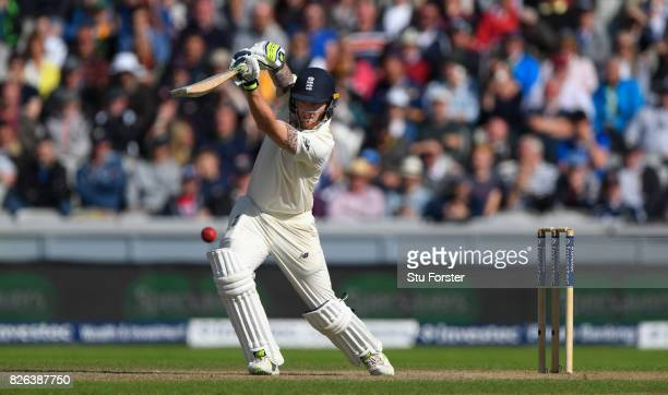 England batsman Ben Stokes drives a ball to the boundary during day one of the 4th Investec Test match between England and South Africa at Old...