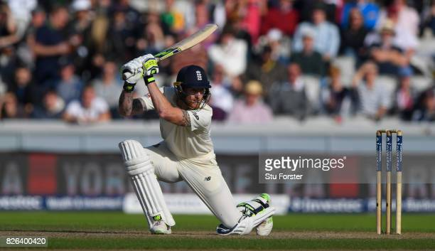 England batsman Ben Stokes drives a ball towards the boundary during day one of the 4th Investec Test match between England and South Africa at Old...