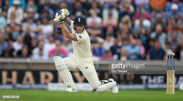 England batsman Ben Stokes drives a ball towards the boundary during day one of the 2nd Investec Test match between England and West Indies at...