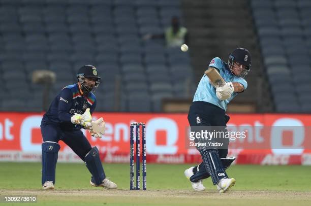 England batsman Ben Stokes hits out watched by India wicketkeeper Rishabh Pant during the 2nd One Day International between India and England at MCA...