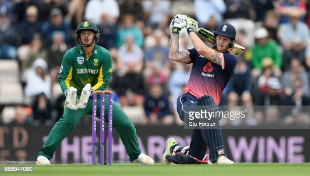 England batsman Ben Stokes hits out watched by keeper de Kock during the 2nd Royal London One Day International between England and South Africa at...