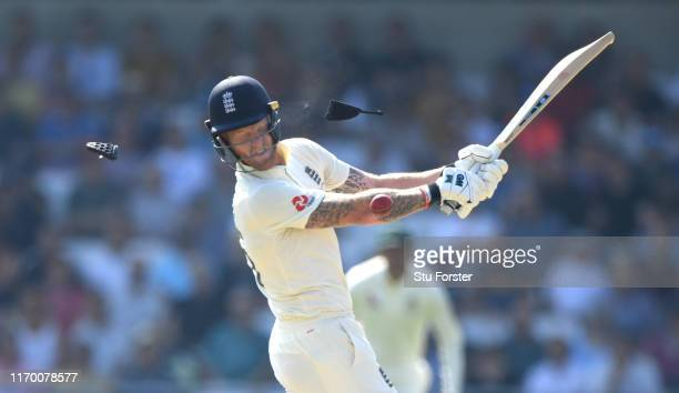 England batsman Ben Stokes is hit on the helmet by a ball from Hazlewood during day four of the 3rd Ashes Test Match between England and Australia at...